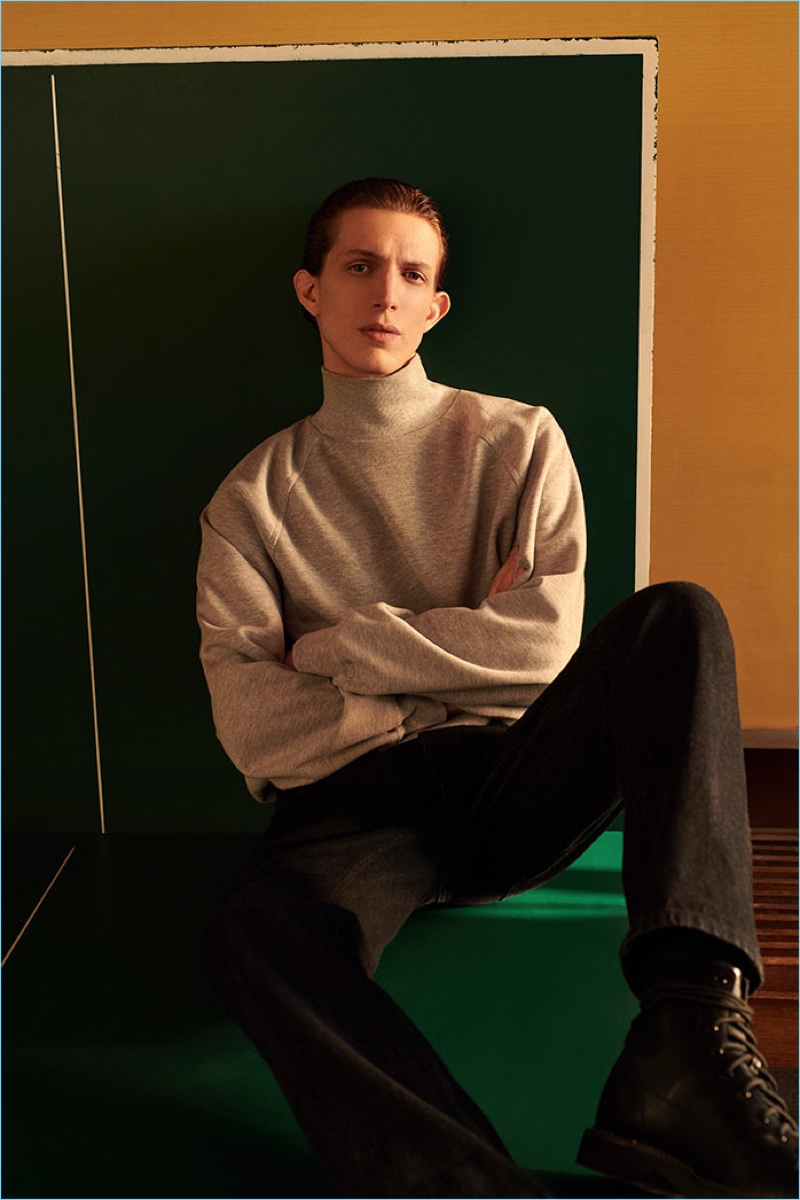 A chic vision, Xavier Buestel wears a turtleneck and jeans from Reserved's Re.Design.02 collection.