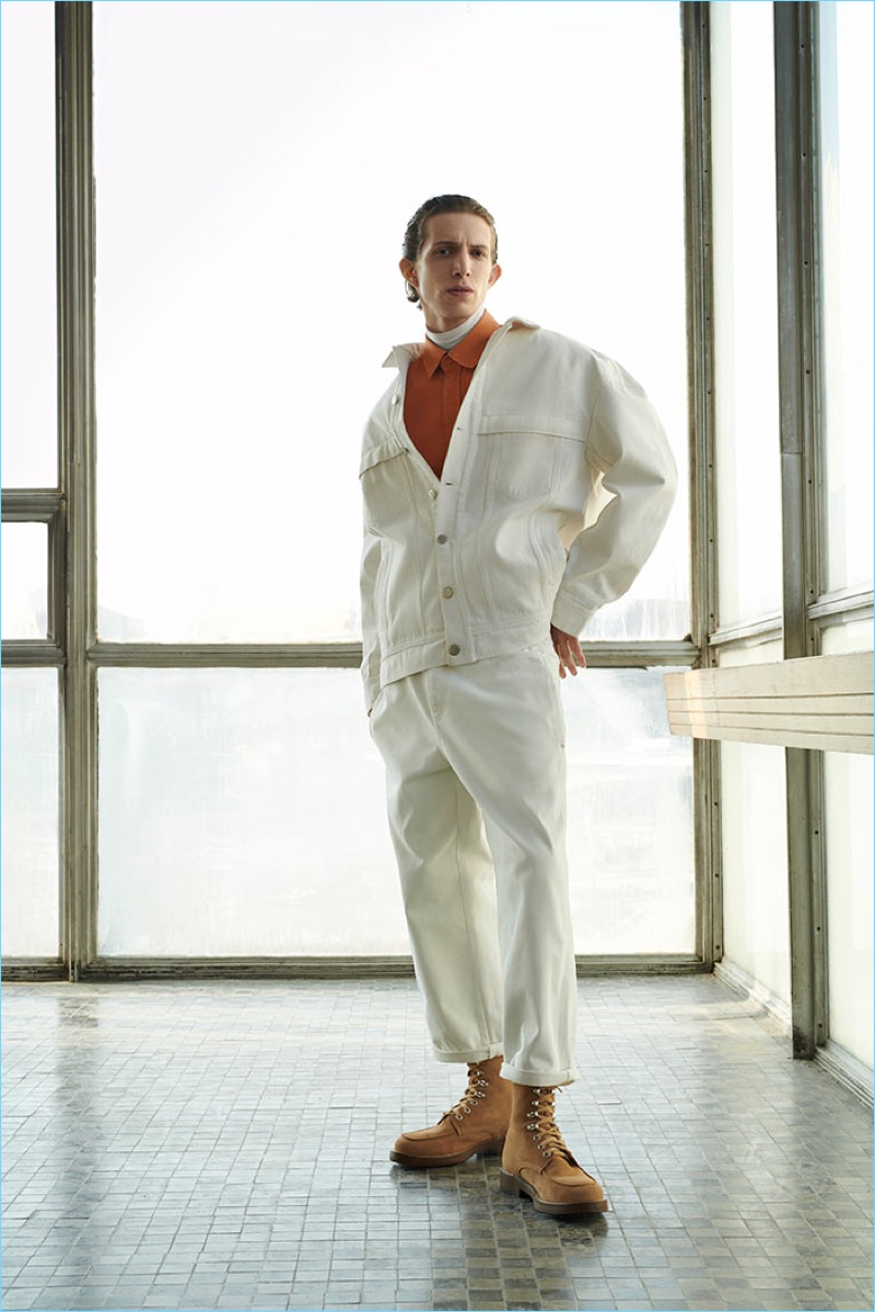 Rocking oversized white denim, Xavier Buestel wears a look from Reserved's Re.Design.02 collection.