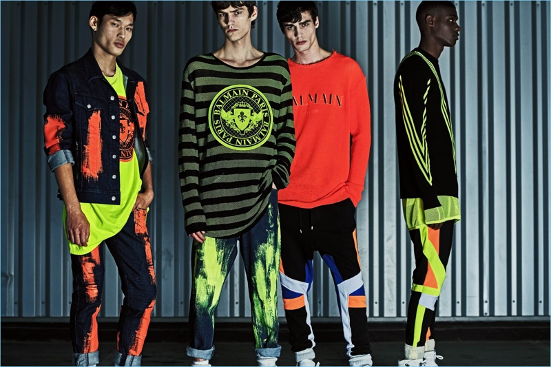 Models Chun Soot, Elias de Poot, Oussama Guessoum, and Rachide Embalo sport fluorescent colored outfits from Balmain's resort 2019 collection.