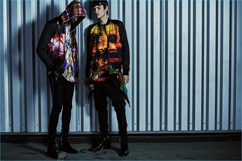 Rachide Embalo and Elias de Poot model Balmain bomber jackets with prints of a tropical sunset.