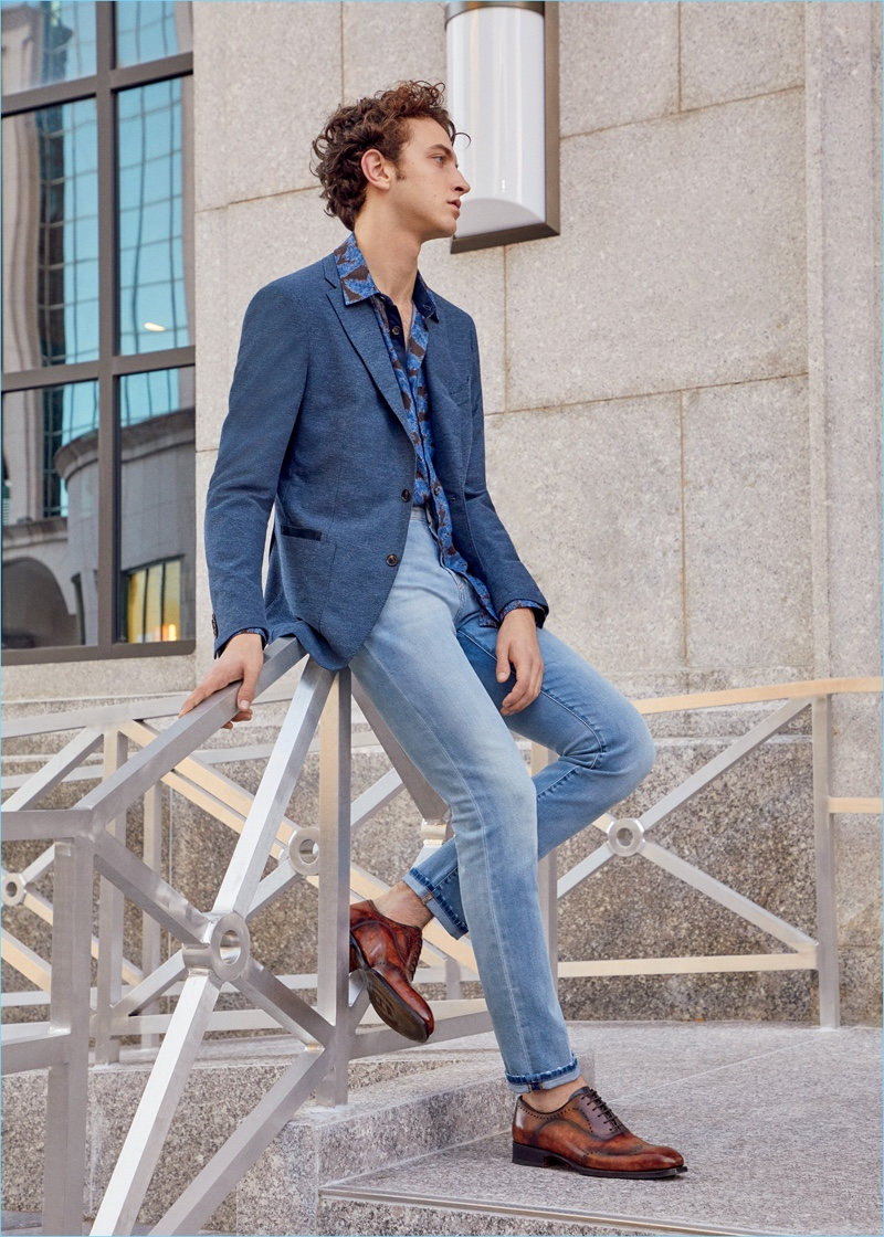 Niels Trispel dons a Luciano Barbera two-button sportcoat, Marco Pescarolo jeans, and Harris leather shoes.