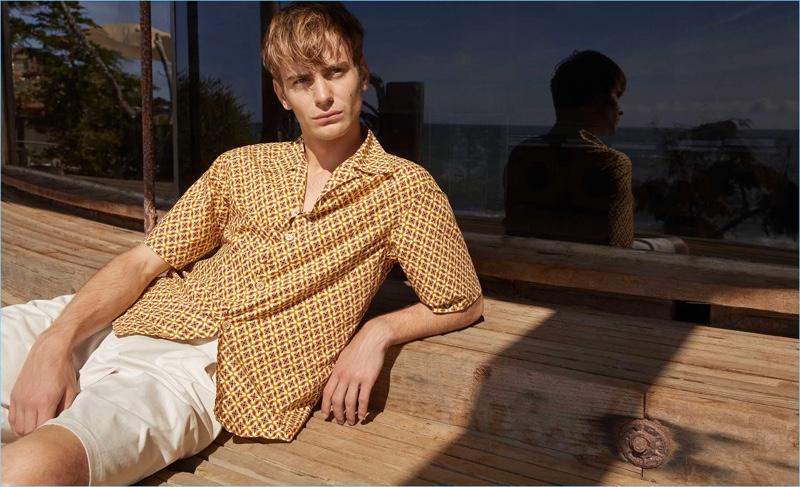 Ben Allen dons a Prada floral print shirt with Giorgio Armani shorts.