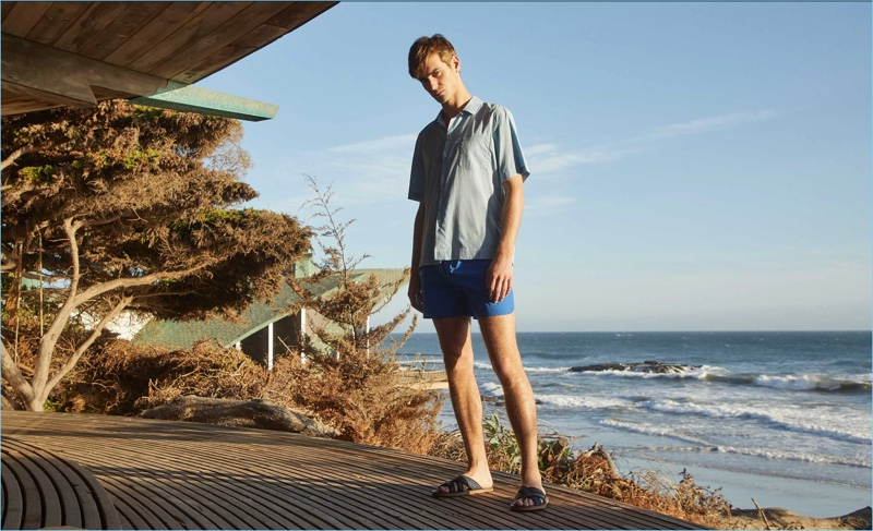 Sporting a shirt and swim shorts by Everest Isles, Ben Allen also wears Armando Cabral slide sandals.