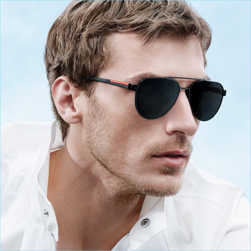 French model Clément Chabernaud sports sunglasses for Prada Linea Rossa's new campaign.
