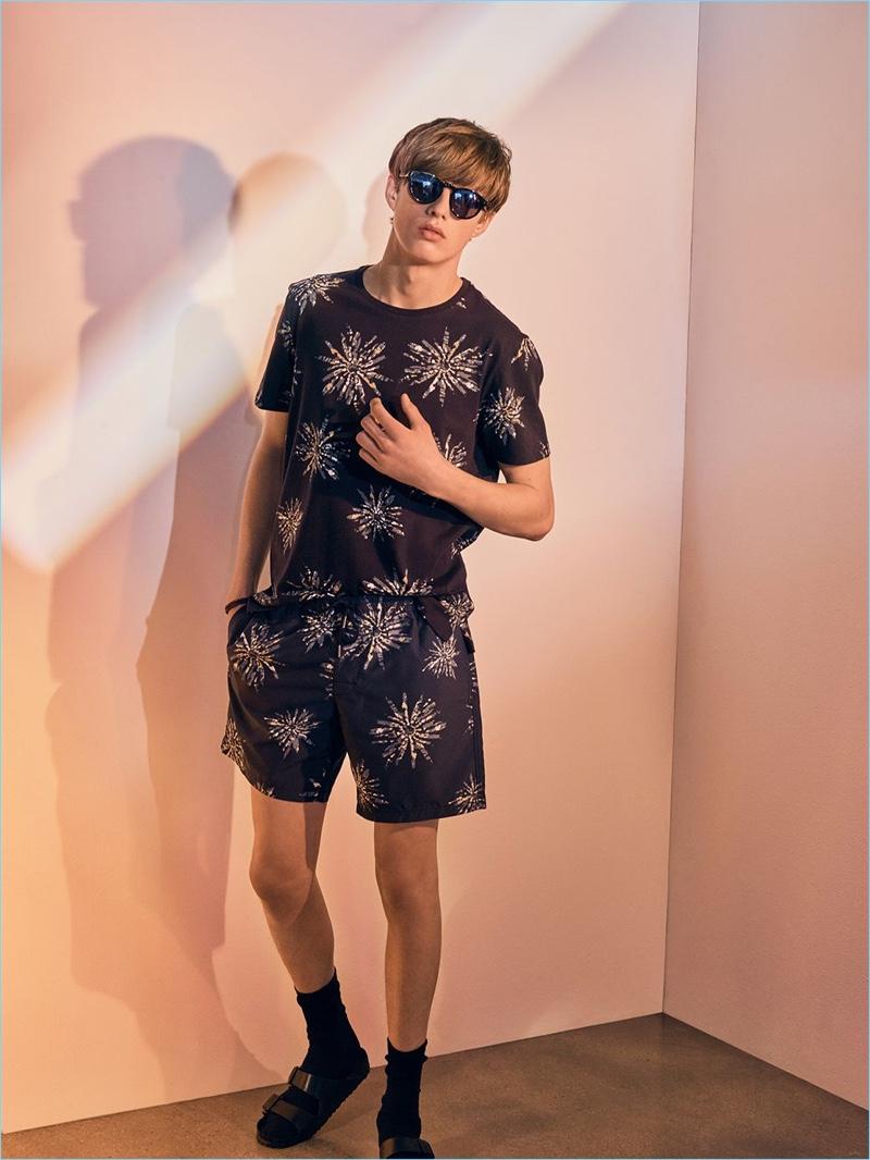 4c612a53c6 Gideon Yendell wears a sunburst tee and swim trunks from Club Monaco. He  also rocks