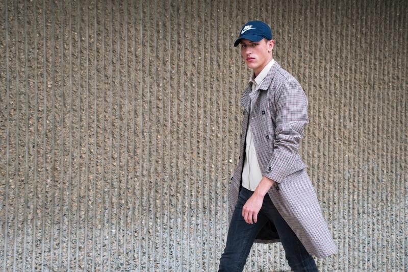 Deakin wears trench Topman, jacket Zara Man, cap NIKE, and jeans Dr Denim.