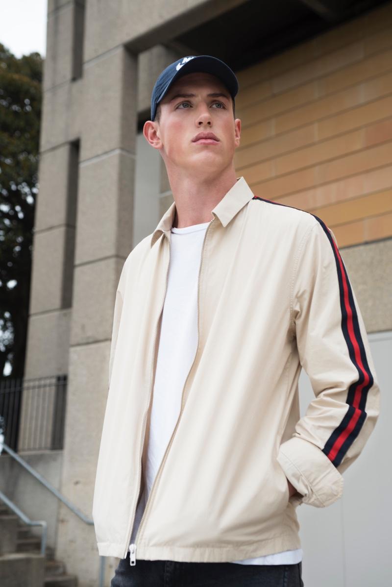 Deakin wears jacket Topman, cap Nike, and t-shirt Calvin Klein.