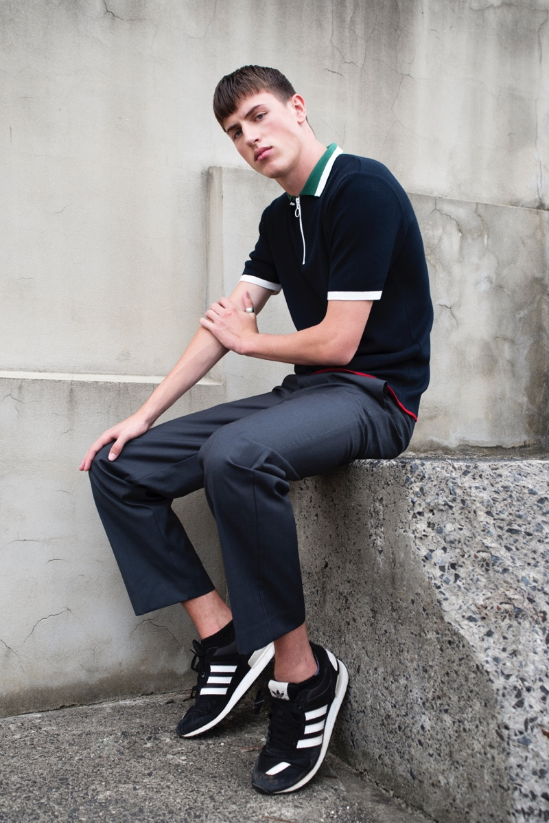 Deakin wears polo Topman, pants Mr. P, and sneakers Adidas.
