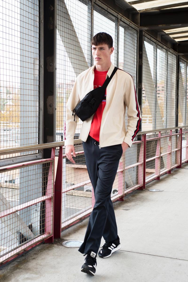 Deakin wears pants Mr. P, bag NICCE, t-shirt and jacket Topman.