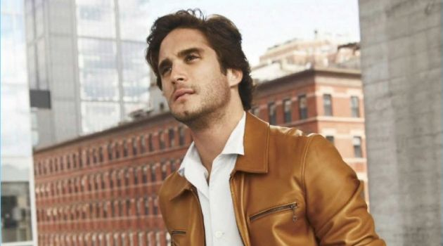A smart vision, Diego Boneta wears a shirt and leather jacket by Salvatore Ferragamo. Boneta also rocks Prada trousers.