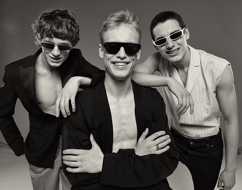 Left to Right: Artem wears tuxedo jacket Saint Laurent, trousers COS, and sunglasses ASOS. Dmitry wears jacket Maison MArgiela, pants Dior Homme, and sunglasses Dior Homme. Misha wears vest Salvatore Ferragamo, jeans Versace, and sunglasses ASOS.