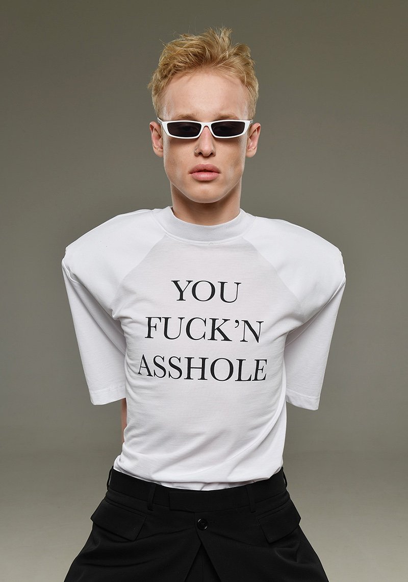 Dmitry wears sunglasses ASOS, t-shirt Vetements, and pants Dior Homme.