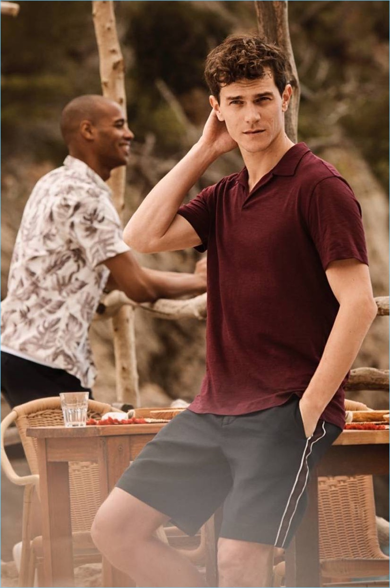 Vincent LaCrocq models a H&M polo shirt in burgundy with slim-fit city shorts.
