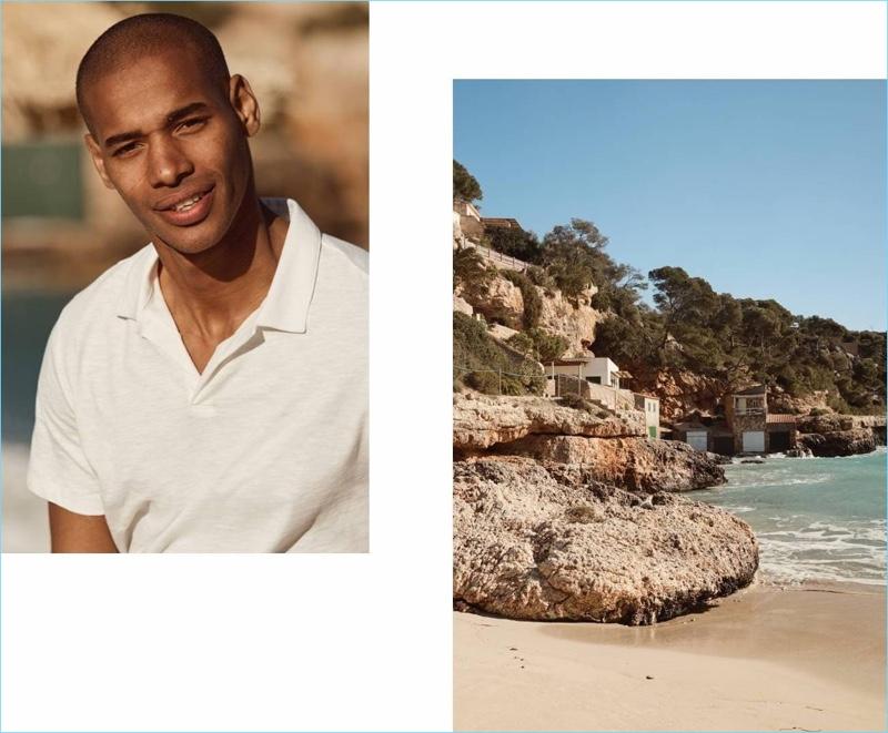 Sacha M'Baye dons a white H&M polo shirt.