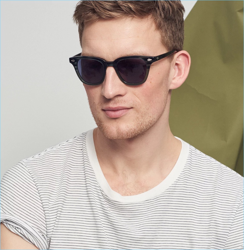 Sunglasses: Bastian Thiery wears J.Crew sunglasses with a striped t-shirt.