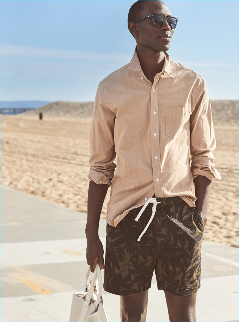 Ready for vacation, Armando Cabral dons J.Crew's stretch dock shorts with a palm camo print.