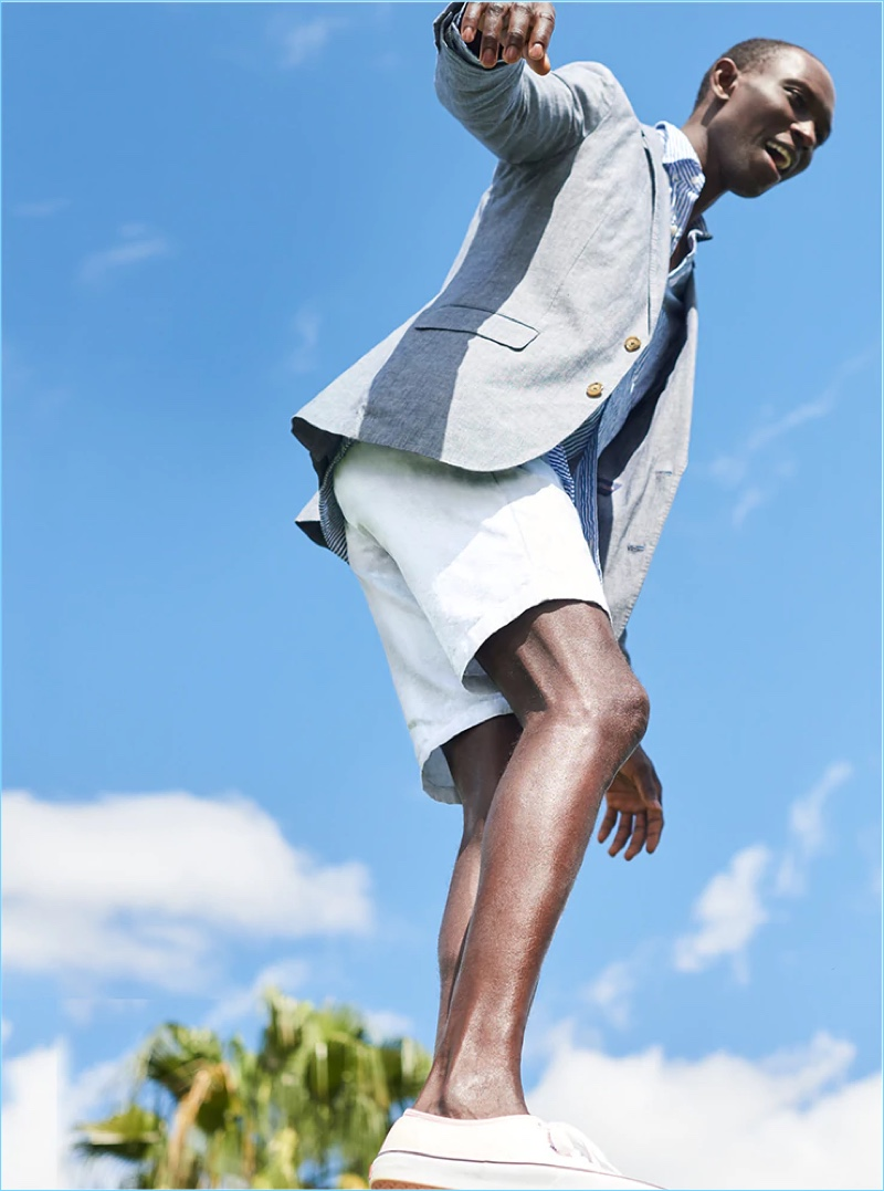 "Armando Cabral dons J.Crew's smart 10.5"" stretch shorts in stone."