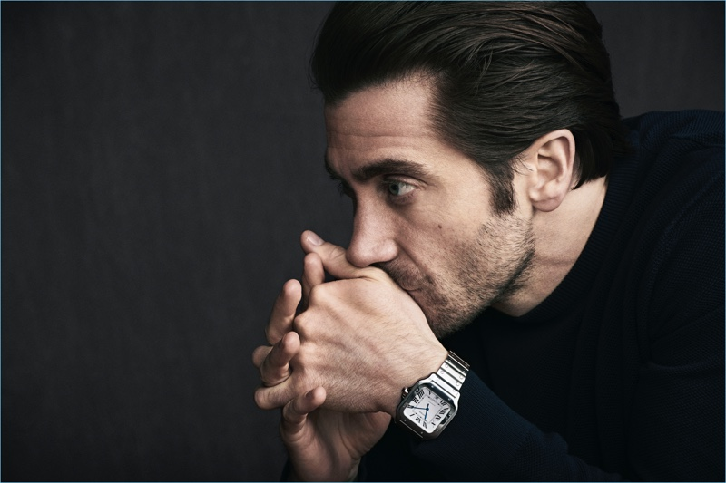 Delivering a side profile, Jake Gyllenhaal appears in a campaign for the Santos de Cartier timepiece.