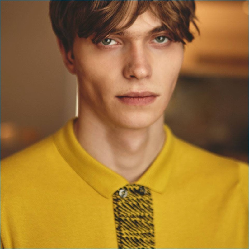 Embracing a pop of color, Jake Love wears a yellow polo from John Smedley.