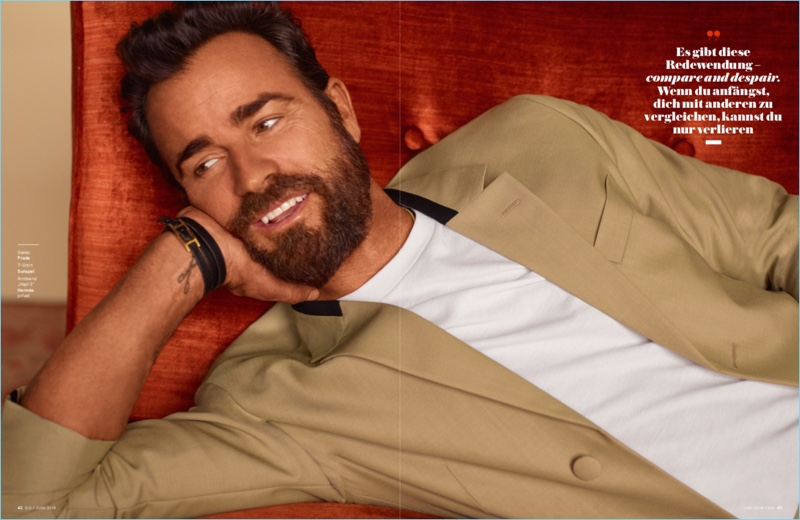 Starring in a photo shoot for GQ Germany, Justin Theroux wears a Prada jacket, Sunspel t-shirt, and Hermès bracelet.