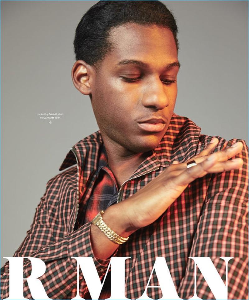Starring in a photo shoot, Leon Bridges wears a check Dunhill jacket with a Carhartt WIP shirt.