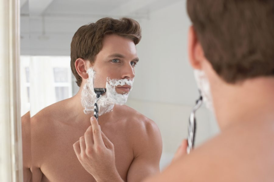 Handsome Man Shaving in Mirror Safety Razor