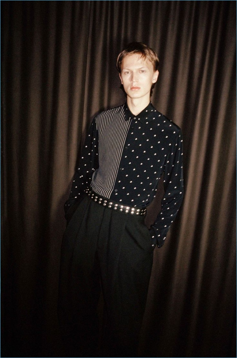 Sporting a polka dot shirt, Jonas Glöer stars in McQ's spring-summer 2018 campaign.