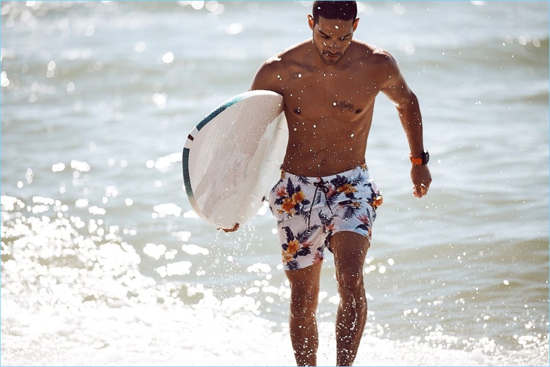 Daniel Pimentel takes to the beach in floral print swim shorts from Nautica.