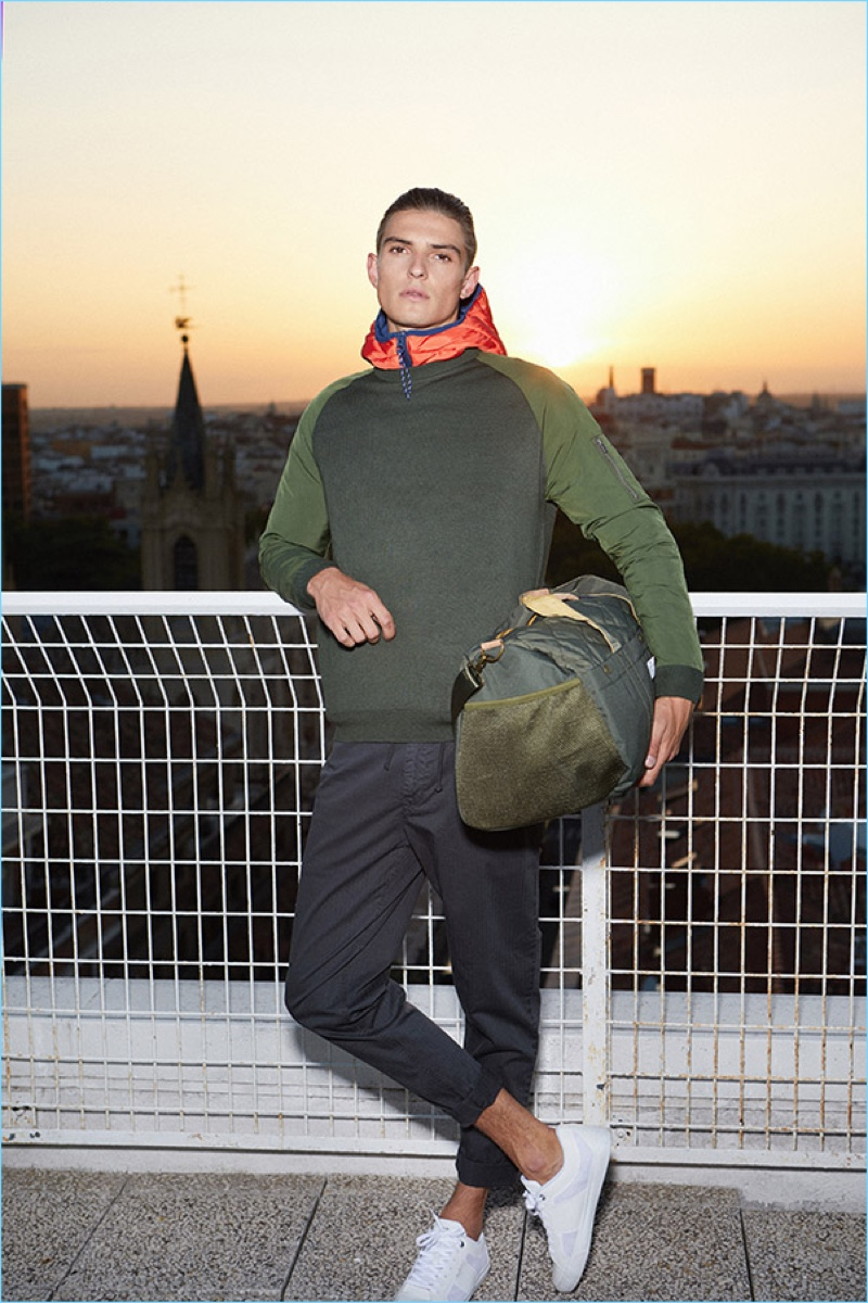 Embracing sporty style, Guerrino Santulliana rocks a pre-fall 2018 look from Pepe Jeans.