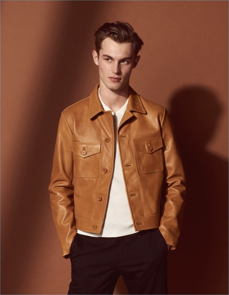 Kit Butler dons a brown leather jacket from Sandro's Mr Porter summer capsule collection.