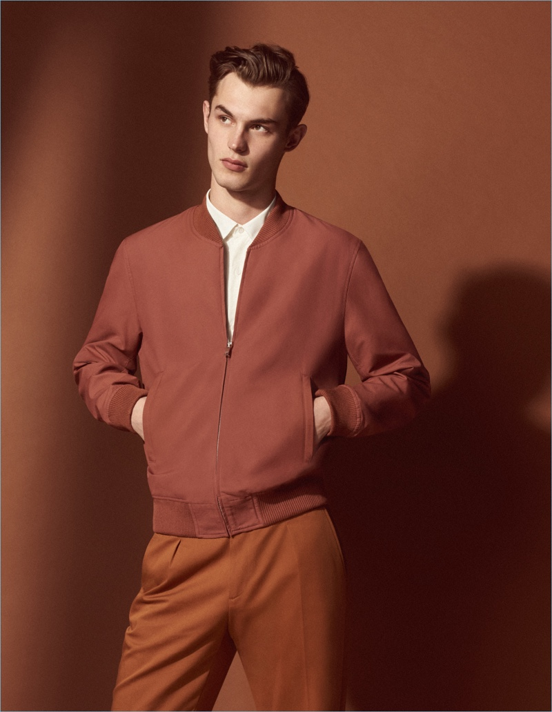 British model Kit Butler embraces monochromatic dressing in a look from Sandro's Mr Porter collaboration.