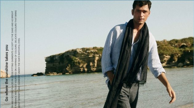 Connecting with Massimo Dutti, Sean O'Pry wears a linen band collar shirt. He also dons a linen scarf and chinos.
