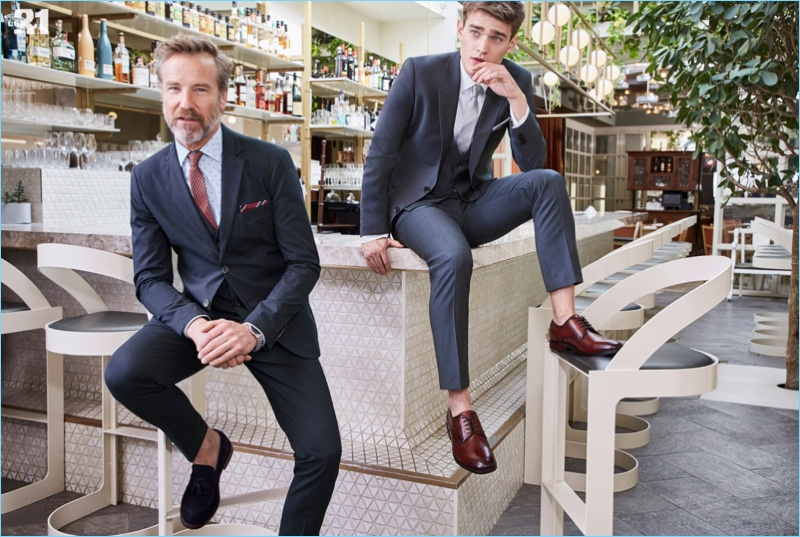 Rainer Andreesen wears a Gianni Lupo striped suit in navy. Meanwhile, Bo Develius dons a LE 31, shirt, suit, and tie with Steve Madden derby shoes.