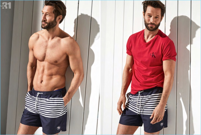 Left: Ready for the beach, John Halls rocks I.FIV5's striped sailor swim trunks in navy. Right: He pairs his swim trunks with a Calvin Klein Jeans red CK logo t-shirt.