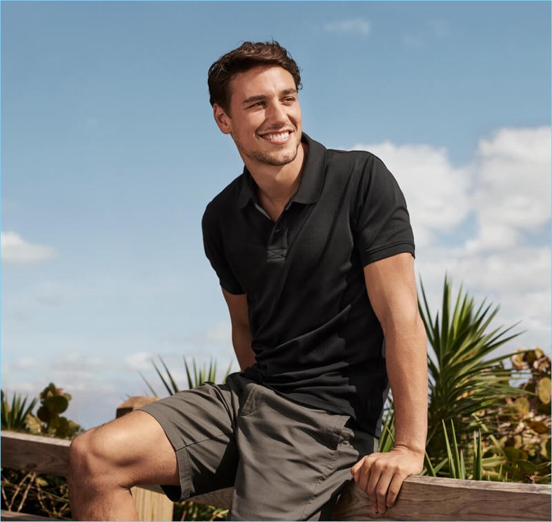 All smiles, Mariano Ontañon fronts the Tomas Maier x UNIQLO campaign.