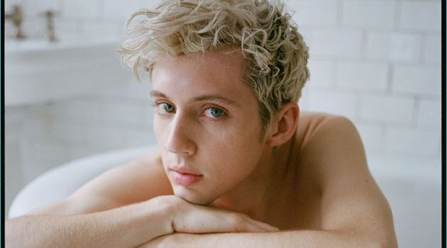 Posing in a bathtub, Troye Sivan rests on a Stella McCartney sweater.