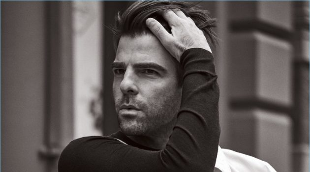 Starring in a photo shoot, Zachary Quinto wears a BOSS coat and trousers with a Hermès sweater.