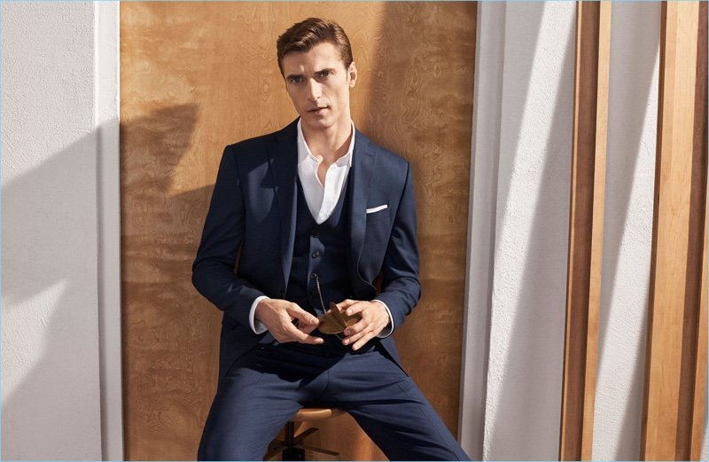 Clément Chabernaud dons a navy three-piece suit by Zara.