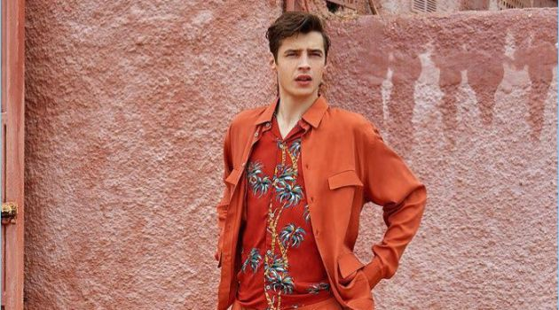 Adrien Sahores wears a shirt and pants by Lemaire. The French model also sports a tropical print shirt from The Kooples with Paraboot shoes.