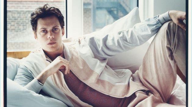 Relaxing in bed, Bill Skarsgård wears Ermenegildo Zegna Couture.