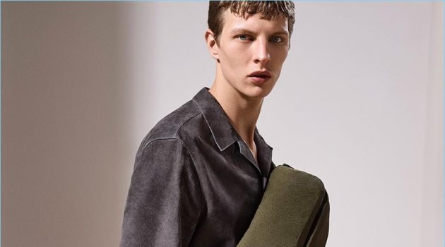 Model Tim Schuhmacher sports Dunhill's trendy belt bag with a suede shirt.