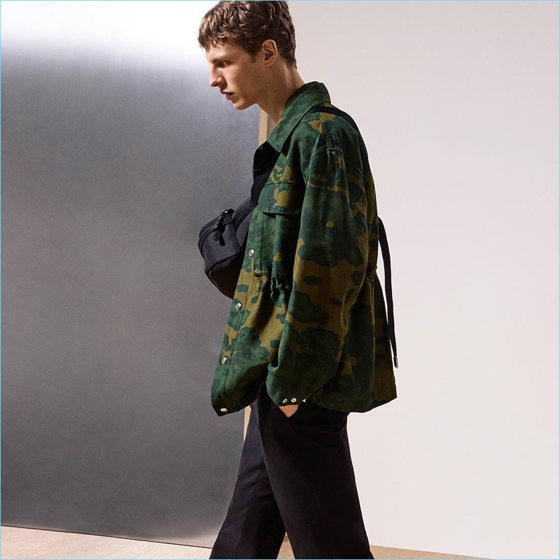 Enjoying a camouflage moment, Tim Schuhmacher wears Dunhill's foliage print shirt jacket.