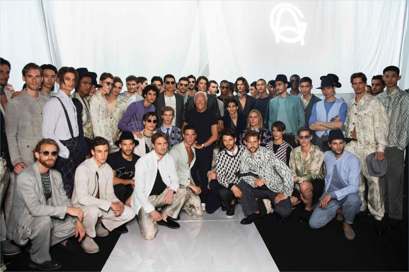 Designer Giorgio Armani poses with the models who walked in his label's spring-summer 2019 show.