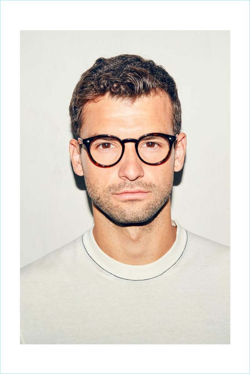 Ready for his close-up, Grigor Dimitrov sports a Dunhill t-shirt and Ray-Ban glasses.