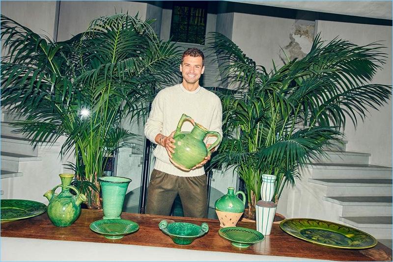 All smiles, Grigor Dimitrov wears a Brunello Cucinelli sweater, Dunhill t-shirt, and Rubinacci trousers.