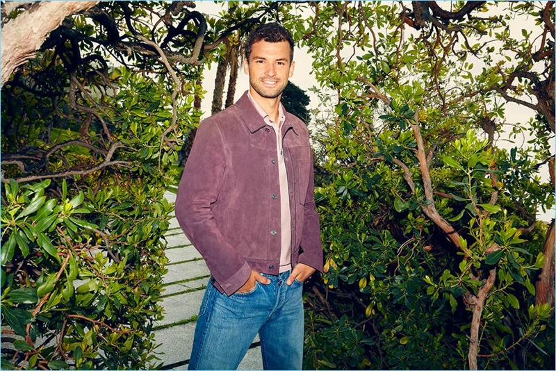 Starring in a style shoot, Grigor Dimitrov wears a Dunhill polo shirt and Brunello Cucinelli jeans.