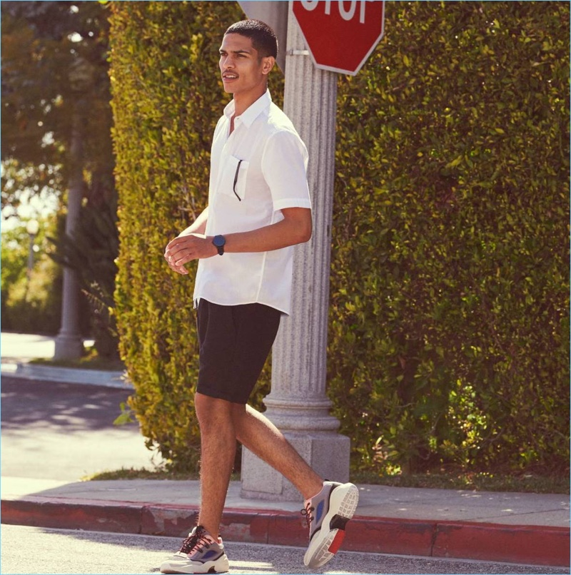 Embracing black and white, Geron McKinley wears a cotton shirt and linen-blend shorts from H&M.