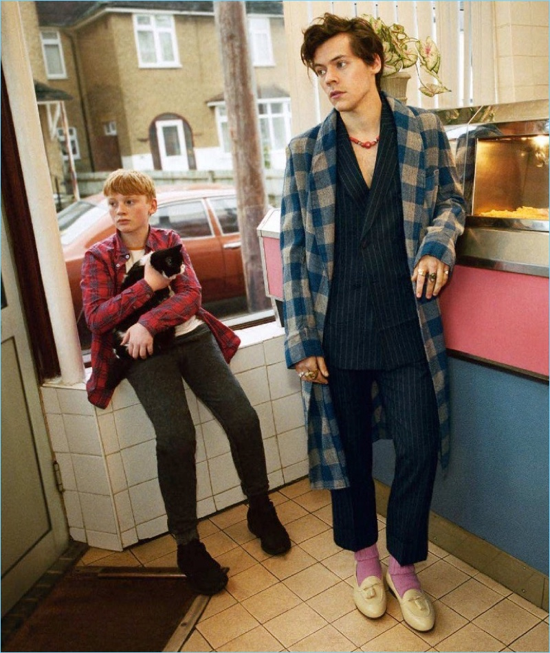 Donning a check coat and sharp suit, Harry Styles stars in Gucci's Tailoring campaign.