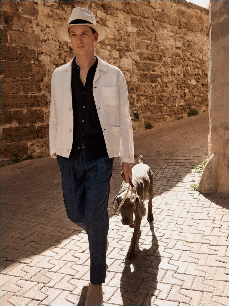 Staying cool, Hugo Sauzay dons a linen look from Mango Man.