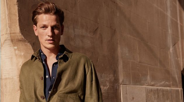 Embracing military style, Hugo Sauzay models a lightweight linen jacket by Mango Man.